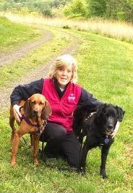 Colleen Campbell with dogs in field